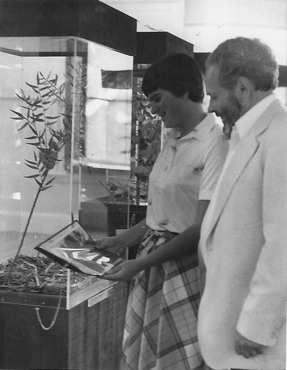 "Kari Jo and Bob Spear, examining ""Habitat Shots""  1981,  Photographer unknown"