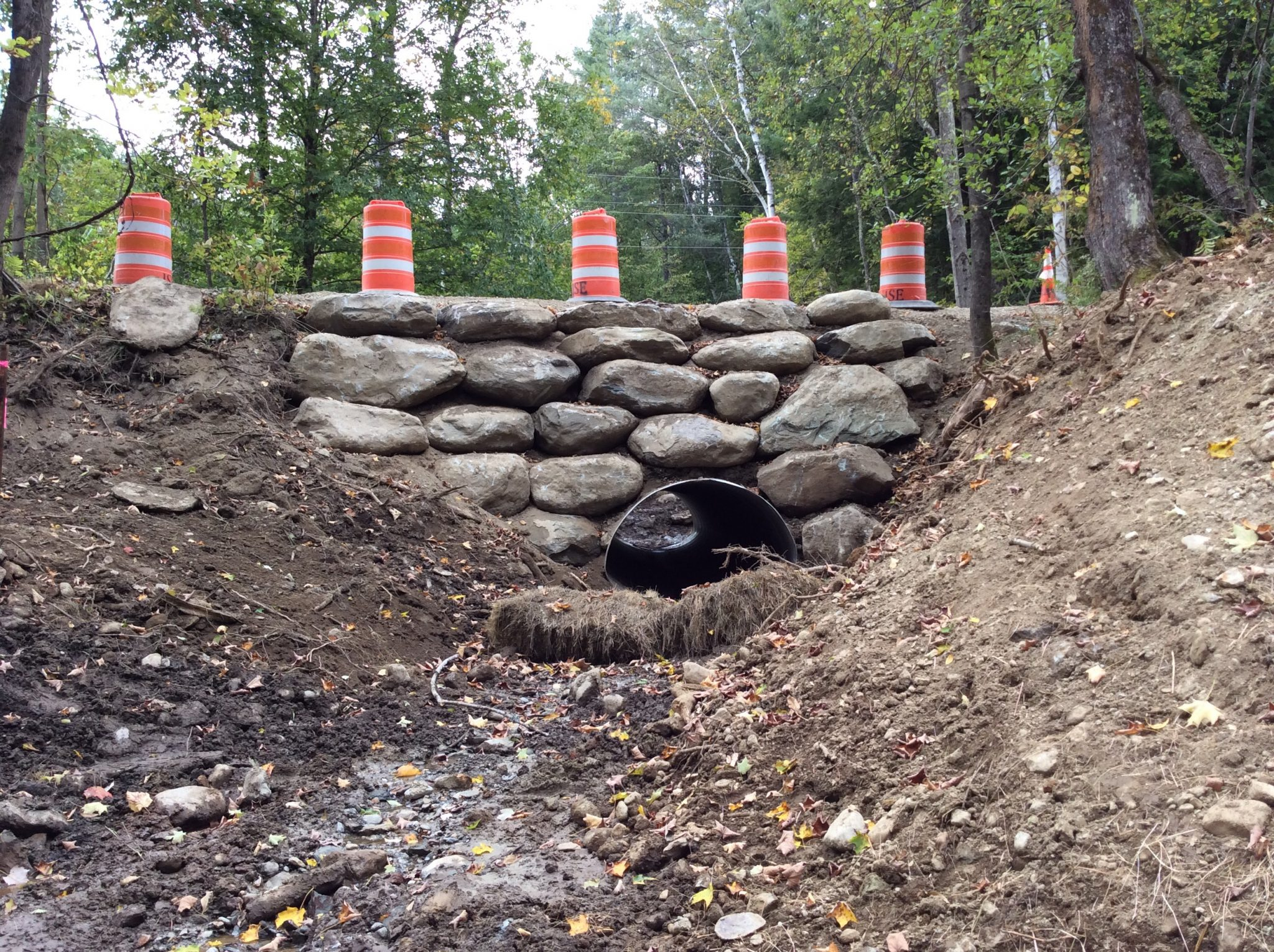 Boulders to support and protect the culvert and the road
