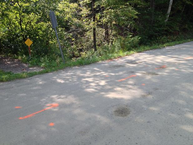 Spray paint markings to guide the road crew when they begin to replace the culvert.