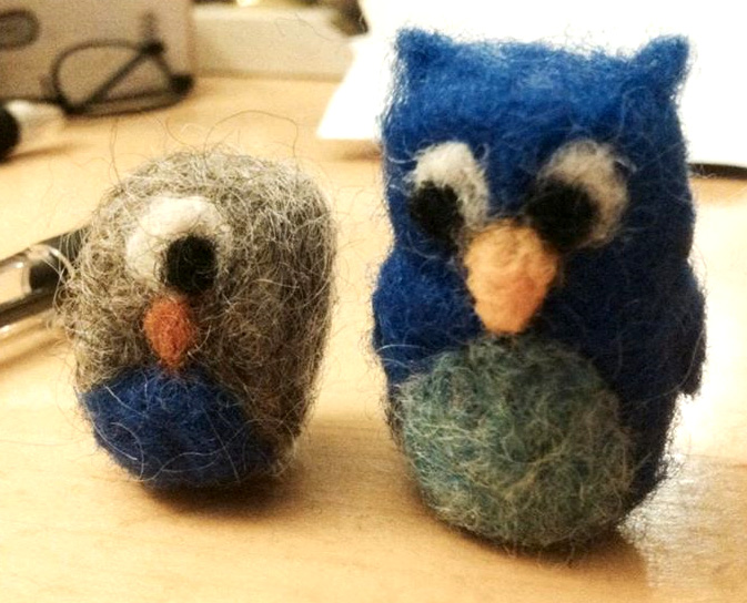"Needle felted owls by M. Barnes and K. Talmage. Wool, less than 2"" tall."