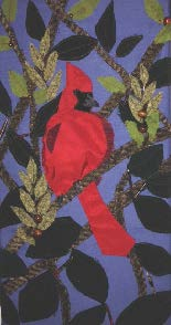 D. Littlepage's textile collage of a Northern Cardinal.
