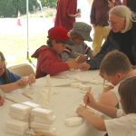 Ingrid teaches soap carving to children at Dead Creek Wildlife Day