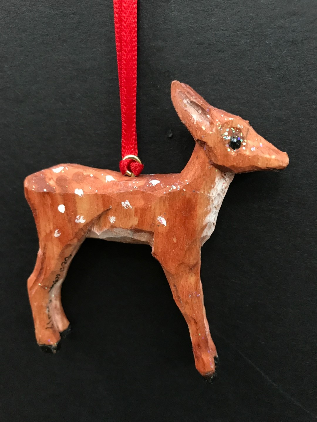 deer (fawn) ornament by D. Tuttle: carved from wood and painted