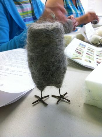 making a felted owl: Work In Process 3 (gray wool has been needled to the white wool inner body. Owl is standing on its wire legs for photo)