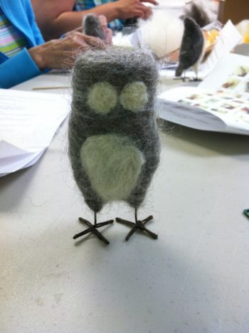 making a felted owl: Work In Process 4 (More white has been added ot this body: this owl has a white breast white around the eyes. Owl is standing on its wire legs for photo)